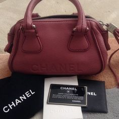 CHANEL BAG. Authentic. HOST PICK ✌️✌ This is an authentic Chanel bag bought in Cannes,France  at a Chanel boutique . It is in mint condition inside and out. It is a mauve pink leather color with a great tassel  on zippered top with the Chanel logo on the bag and on the silver hardware. Don't know if I want to part with this as yet so if you are a collector of fine bags, I will entertain offers CHANEL Bags
