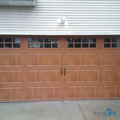 This garage door has an authentic carriage house style with a wood-look in a premium, low maintenance material. This beautiful door provides a traditional style with trending energy efficiency construction and state-of-the-art technology for safety and convenience. | Project and Photo Credits: ProLift Garage Doors of St. Louis | The door shown here is from Clopay's Ultra Grain Collection in Oak