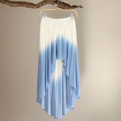 """Flowy chiffon hi-lo skirt with sky blue dip-dye print. High waist with elastic waistband.  Photo Shown: Size S Front length: 16.5"""" Back length: 38"""" Waist: 12.5"""" 100% Polyester Gentle Wash in cold water"""