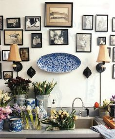 Love the combination of old family photos and the blue and white china.