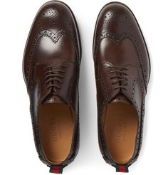 Gucci - Stripe-Trimmed Leather Wingtip Brogues. These handsome leather shoes are unmistakably the work of Gucci. This pair is trimmed with the brand's signature red and green striped webbing - a nod to the label's equestrian roots as it was originally used to secure saddles. The rich brown uppers are neatly detailed with wingtip broguing for a smart, sophisticated look.