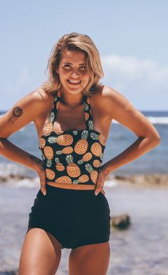 Pretty Pineapple Princess. Modest this modest two piece swimsuit from Beverly Swimwear. Black high waisted bikini bottoms with a long midkini top with adorable pineapples for the summer time
