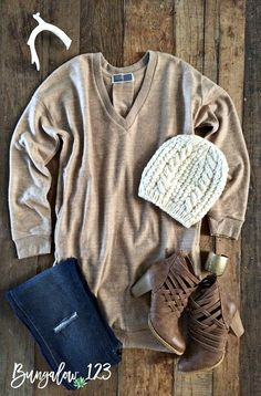 Ultra-soft and cozy sweater tunic in Soft Camel. V-neck with full-sleeve and two front pockets. Add a pair of our B123 Seamless or Fleece Leggings or denim underneath. If in-between sizes, we recommen