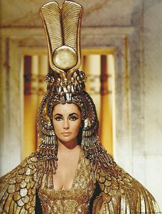 Elizabeth Taylor as Cleopatra, Queen and Priestess of Isis...