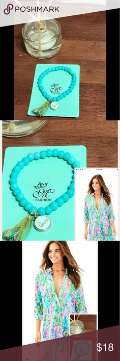 Turquoise ceramic-bead LOVE charm, tassel bracelet Trendy and sweet Love charm bracelet with ceramic beads and colorful tassel! Cute pairing with any outfit, my personal favorite pairing is Lilly Pulitzer! T&J Designs Jewelry Bracelets
