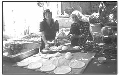 Nomadic women prepare bread to be baked on a griddle over an open fire. EPD Photos/Jeannine Davis-Kimball