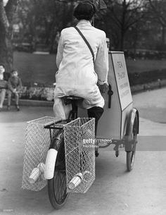 A woman rides a cycle tea trolley through the London Zoo, 7th April 1947.