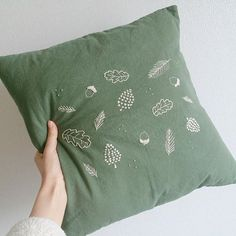 Leaf pattern embroideries on a cushion