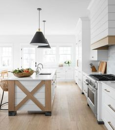 White kitchen wood trim: shiplap island with low back wicker stools. Kitchen Island With Legs, Kitchen Islands, Kitchen Decor, Kitchen Design, Patio Kitchen, Kitchen Wood, White Shaker Kitchen, Cottage Kitchens, White Kitchens