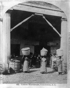 African Americans working, Charleston, S.C.: Cotton warehouse, carrying cotton. c.1879