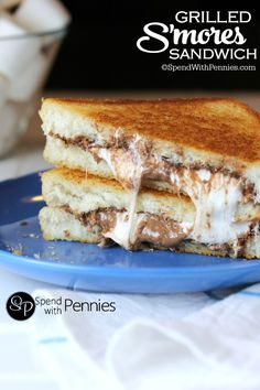 Grilled S'mores Sandwich! Like heaven on a plate! Perfectly grilled bread loaded up with ooey gooey marshmallows & chocolate!