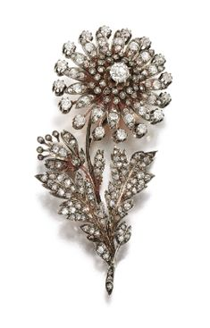 DIAMOND BROOCH, LATE 19H CENTURY Estimate: 2,000 - 3,000 GBP  LOT SOLD. 3,750 GBP  (Hammer Price with Buyers Premium) Designed as a flower, the flower headset en tremblant, set with circular-cut and rose diamonds, brooch fitting detachable, two small stones deficient.