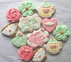 Pink, coral, mint green, gold hearts, flowers, and tea themed Mothers Day decorated sugar cookies by Charlotte Gushue of Cookie Starts with C