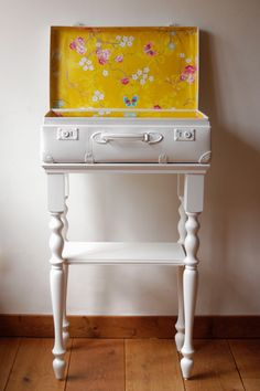 Upcycled suitcase by Petite Dumoulin  I love this white suitcase table with the fun yellow interior.  Such a happy piece!  ReHouse occasionally gets vintage suitcases in the store, and this would be a sweet suitcase project!   www.rehouseny.com