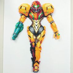 The famous Bounty Hunter, #Samus, has been made into an awesome #perler piece! This is a commission piece! I had a lot of fun making her! I found the design on a shirt a while back and converted it into a sprite and then into this piece! #SamusAran
