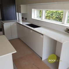 Installed The Aspen De Lusso has been chosen for this hub of the home to brighten up the space and create an all white kitchen. All White Kitchen, Window Sill, Aspen, Granite, Kitchen Cabinets, Home Decor, Decoration Home, Room Decor, Kitchen Cupboards