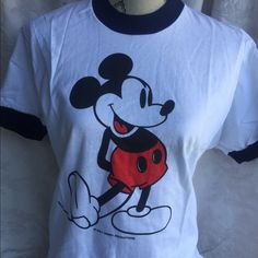 Nwot Mickey Mouse vintage ringer tee Awesome old stock new without tags's Mickey Mouse T-shirt from Disney World excellent condition never been washed size medium such a great iconic and classic look to this great top!!❤️❤️ Disney Tops Tees - Short Sleeve