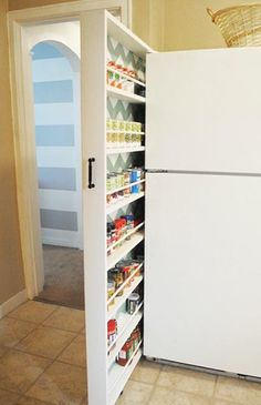 DIY Hidden storage: canned food storage cabinet diy hidden storage canned food storage cabinet, storage ideas, urban living, woodworking projects, Pulls out for easy access to canned goods etc Food Storage Cabinet, Kitchen Storage Solutions, Diy Kitchen Storage, Diy Storage, Storage Ideas, Organization Ideas, Kitchen Pantry, Kitchen Ideas, Kitchen Organization
