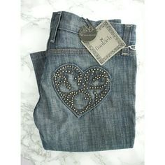 """Sale Frankie B Designer Jeans Studded Heart Pocket Brand NWT! AMAZING designer denim jeans by hard-to-find brand Frankie B! Features adorable studded heart back pockets, unique medium wash, and topstitching. Barely bootcut never goes out of style. FANTASTIC QUALITY! Will wear & wash wonderfully for years.  These are SADLY a re-posh, they are too small for me. My loss is your gain! Retails for $189!  Size 25 approx size 0-2. Inseam measures 33"""".  NO TRADES. Frankie B. Jeans Boot Cut"""