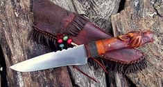 belt knife with carved wolf head grip and frontier sheath
