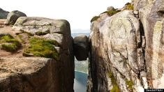 kjeragbolten. Norway.  See that boulder? You can stand on it. Where else can you hover thousands of feet above solid ground, suspended in the crevice of a mountain?