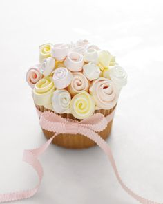 Well, cupcakes (plural) actually. Find a slideshow of 31 cupcake ideas at Martha Stewart Weddings. But I find these cupcake blossoms to be so gorgeous, this post is just for them. Wedding Cupcake Recipes, Dessert Bar Wedding, Wedding Desserts, Wedding Cupcakes, Wedding Cake, Diy Wedding, Wedding Bouquet, Wedding Ideas, Floral Wedding