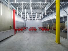 waterfrom design transforms a old factory specializing in water dispenser production and sales using transparent plastic sheets and mesh. Transparent Plastic Sheet, Open Space Office, Old Factory, Workspace Design, Plastic Sheets, Industrial Office, 30 Years Old, Architect Design, Office Interiors