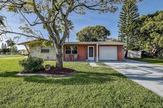 Always wanted to live in Holiday, FL? We've got you covered! This single-family home is perfect for you! Garage Dimensions, Tarpon Springs, Wesley Chapel, Backyard, Patio, City Limits, Gulf Of Mexico, Formal Living Rooms, Tampa Bay