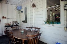 """The covered patio dining area. This area is where they spend their most time, especially with guests, but can get chilly during San Francisco's foggy days (aka most days). A Holland Companion grill is super portable and """"often travels to the beach and car camping with us!"""" The table and chairs were found on Craigslist."""