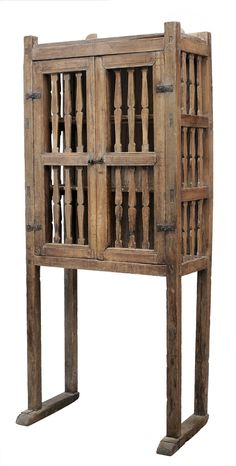Fine Spanish Colonial Pine [Trostero] - Lot 380 from September 2012 Auction - attributed to Santo Tomas, Chihuahua, Mexico, early 19th century, two paneled doors set with carved slats and original iron hinges, three paneled sides, each panel with three slats, some elements of scrolled backsplash remain, tenon and pinned construction throughout, some traces of blue paint, 84 x 36 x 21 in - Estimate $4,000 to $6,000