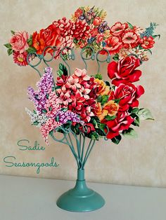 A thrifted wire card/photo holder gets a Spring-y paint job in order to hold bright, splashy flowers from vintage greeting cards! The perfect indoor flower bouquet...better yet, faux-quet! Think #Spring!! #SadieSeasongoods