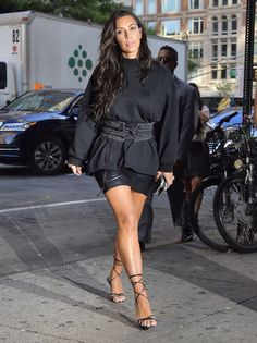 Kim Kardashian Wearing a Distressed Long-Sleeved Tee and Laced Belt