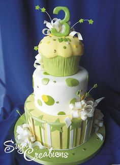 Green and yellow dots....topped with a cupcake.....Cute children's cake