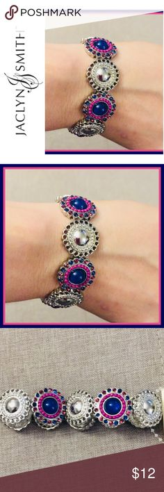 Gorgeous Stretch Bracelet Gorgeous silver toned stretch bracelet with accents of vibrant pinks and navy.  Great piece to add to your collection! Jaclyn Smith Jewelry Bracelets