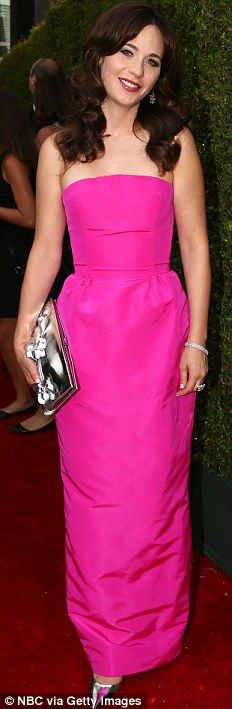 Thinking pink: Zooey Deschanel sported a fuchsia Oscar De La Renta gown with silver Jimmy Choo heels at the 2014 Emmys http://dailym.ai/1lufdYb