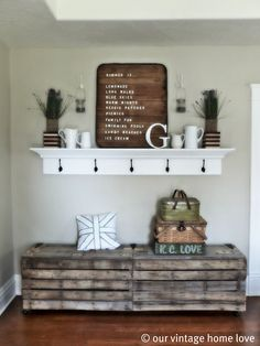 Entry way or mud room bench and coat hanger mantel.