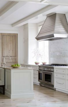 Like the ceiling and the marble slab as a backsplash above stove.