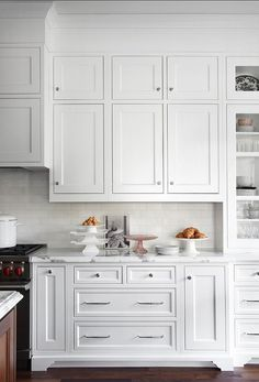 Tall cabinetry, soffit, subway tiles