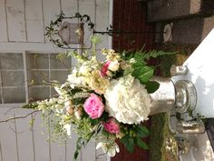 Vintage and romantic floral in a mercury glass container