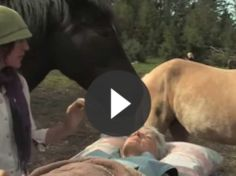 Woman in need of healing lies on a table. See what the horse  does for her.