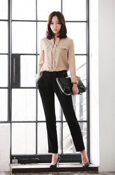Business Attire, nude blouse, black skinny dress pants and black pumps of course.