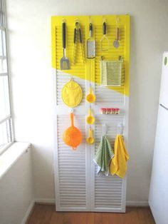 Turn a closet door into an organizer by adding hooks. | 21 Adorable DIY Projects To Spruce Up Your Kitchen