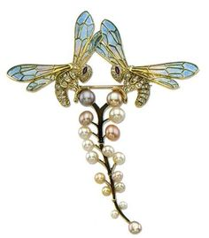 This is incredible (and cute!).  René Jules Lalique brooch with Pearls.