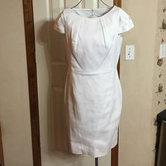 Calvin Klein white Dress Gorgeous white waffle weave dress!  New, with tags!  Bought for Miss OK event and didn't wear!  Zips up back with two buttons!  Excellent condition Calvin Klein Dresses