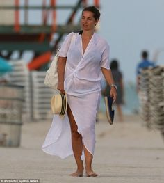 Natural beauty: Louise went bare-faced and wore her hair pulled back for her seaside trip...