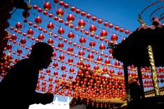 A man praying is silhouetted against traditional Chinese lantern decorations at a temple ahead of the Chinese Lunar New Year in Kuala Lumpur, Malaysia, on Feb. 17. | Image: Joshua Paul/Associated Press | www.piclectica.com #piclectica
