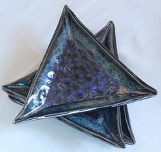 Indigo float over obsidian, ancient jasper slip trailed on rim. Fired to cone 6. By Winchell Clayworks