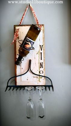 A little Vino.  Upcycled wine wall piece.  Available at Studio 11