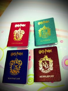 Harry Potter Hogwarts Houses Passport cases.omg. I really want one.