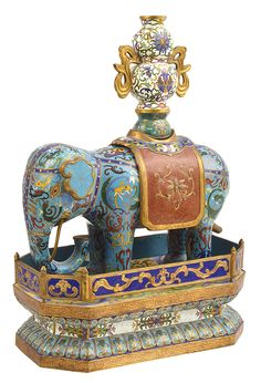 A CHINESE GILT BRONZE AND CLOISONNE ENAMEL FIGURE OF AN ELEPHANT